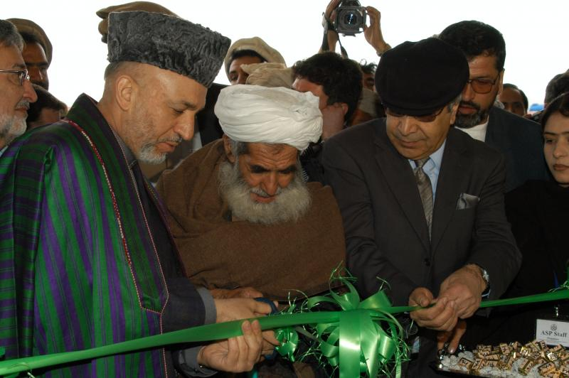 Photos by Shahmahmood Miakhel: President Karzai and Minister of Interior 'Ali Ahmad Jalali during the inauguration of Mohammad Agha district headquarters in Logar province .