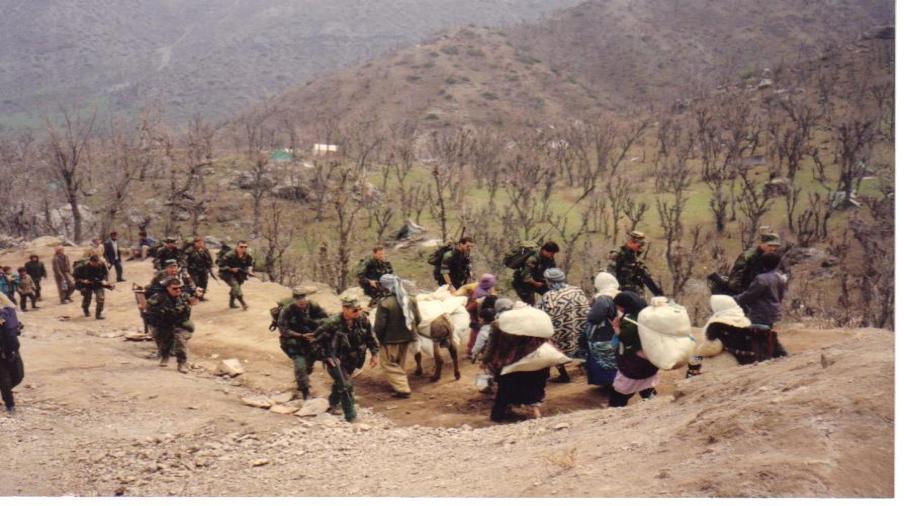 Photo above: U.S. Special Forces team (ODA 013) in Kurdish Refugee Camp, Isikveren, Turkey, April 1991.