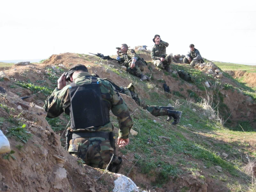 Photo right: NILE team and 10th Special Forces with Peshmerga along the Green Line, April 2003.