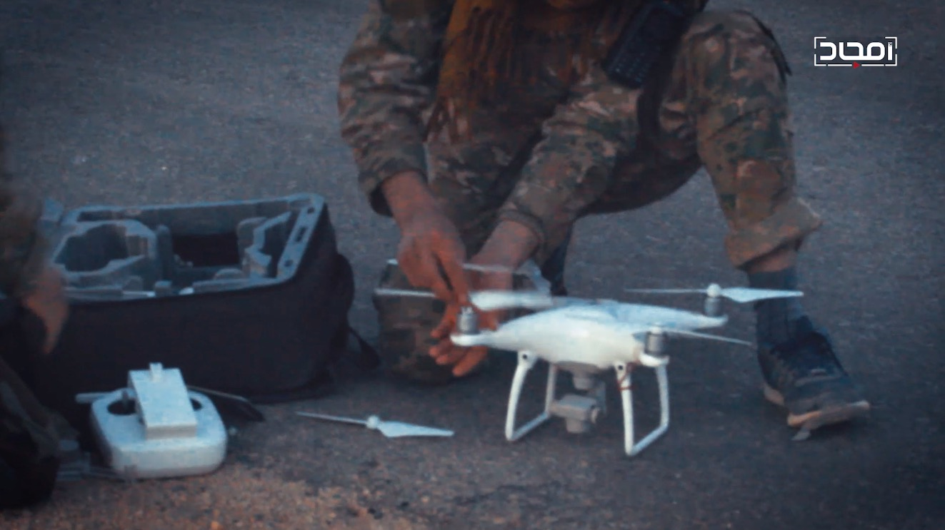 A DJI quadcopter drone operated by an HTS member. From an Amjad video release.