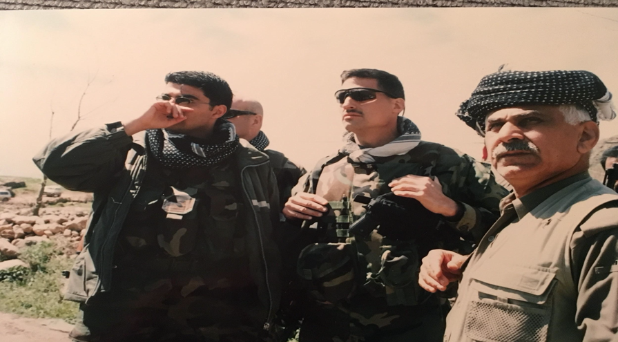 Photo above: Viewing Ansar al-Islam positions. One of the authors and Sheik Jafar, Peshmerga commander of the assault force.
