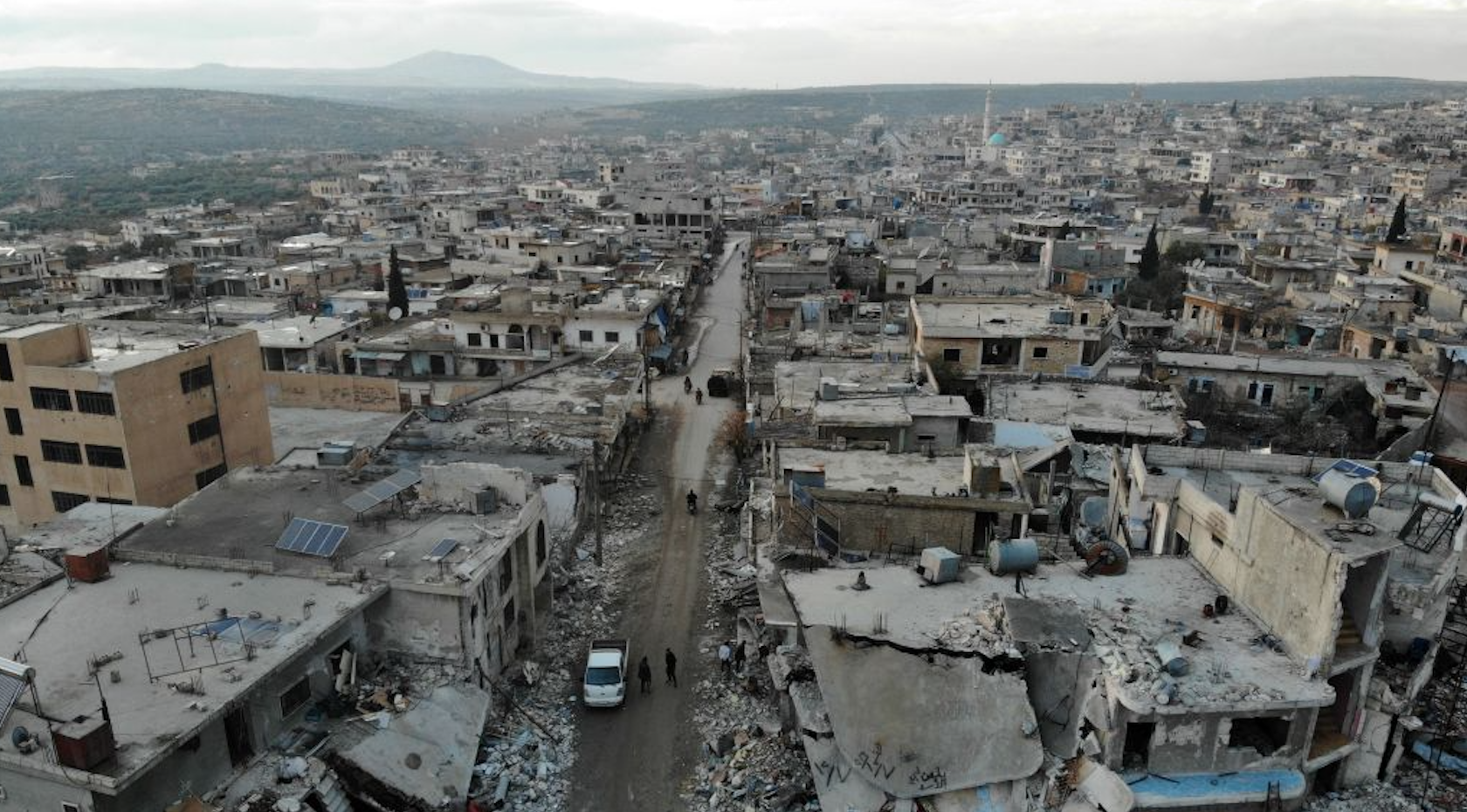 An aerial view taken on December 8, 2019 shows the damage caused by reported Syrian regime and Russian air strikes the previous day in the town of Al-Bara in the south of Syria's Idlib province, that killed at least four civilans, including a child and wounding several others.