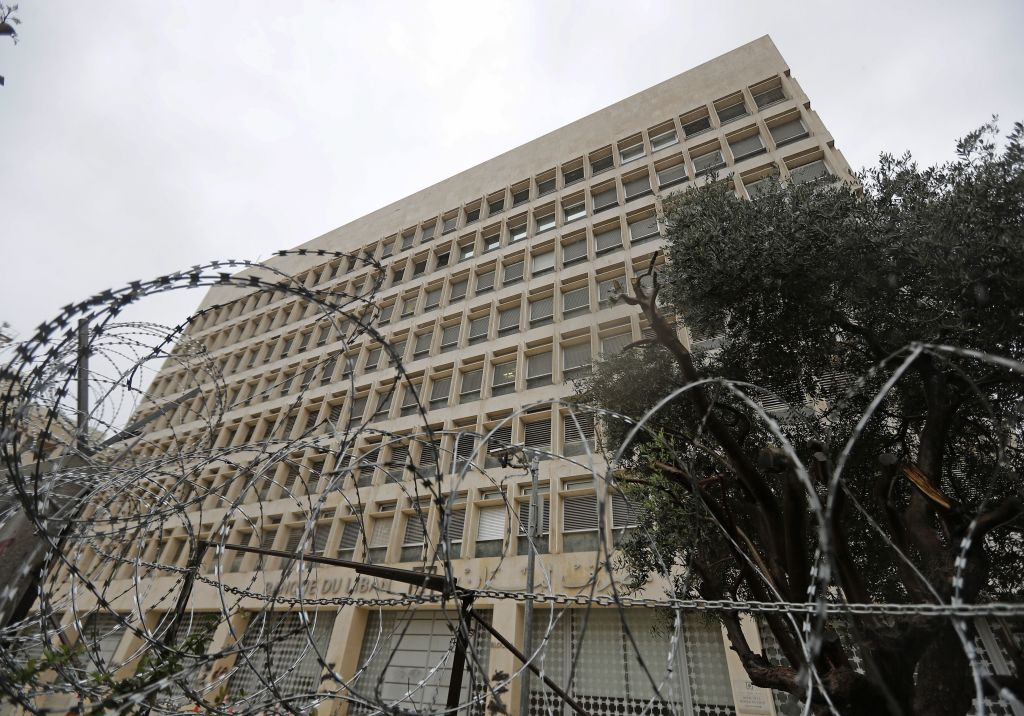 Barbed wire blocks the vicinity of Lebanon's central bank building in the capital Beirut on March 6, 2020. - Lebanon's central bank today ordered money changers to cap their exchange rate at no more than 30 percent above the official peg to contain the pound's devaluation on the parallel market. Debt-ridden Lebanon is facing its most serious economic crisis since the end of its 1975-1990 civil war. (Photo by JOSEPH EID / AFP) (Photo by JOSEPH EID/AFP via Getty Images)