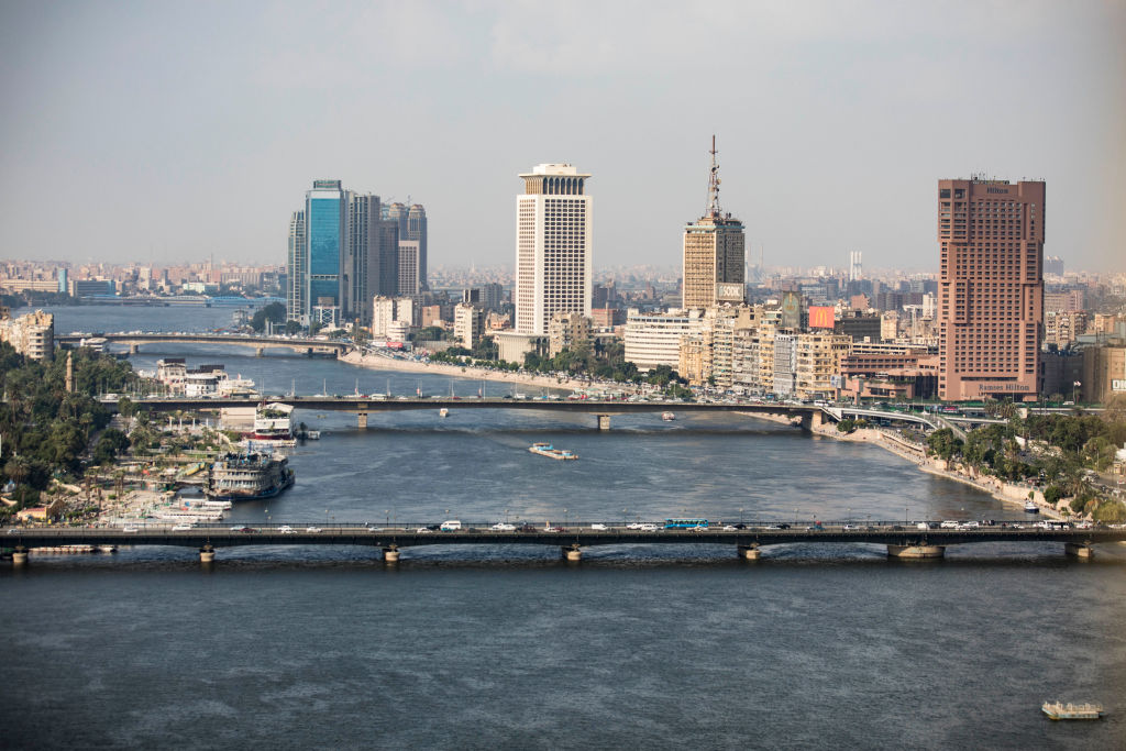 A complete overview of the Ramses Hilton Hotel (R), the Maspero Television Building (C) and the building of the Egyptian Ministry of Foreign Affairs with a view of the Qasr El Nil Bridge (front) on the banks of the Nile.