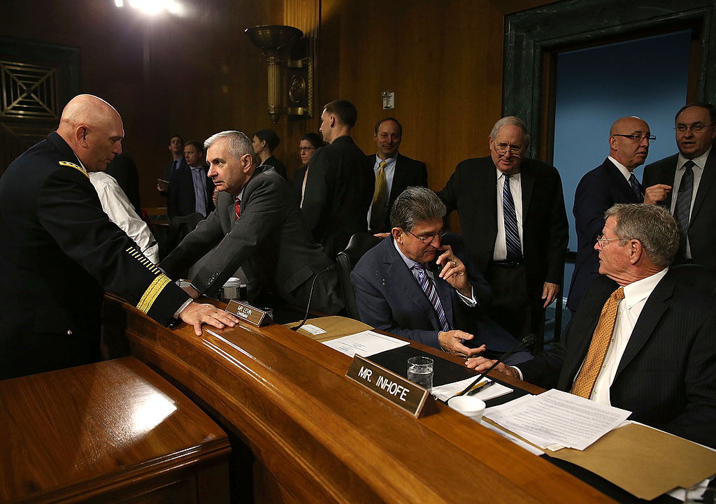 Chief of Staff of the U.S. Army Gen. Raymond Odierno (L), talks with Sen. Jack Reed (D-RI) (2nd-L) while Senators Joe Manchin (D-WV)(C), Chairman Carl Levin (D-MI) and James Inhofe (R-OK) (R) converse, before the start of a Senate Armed Services Committee hearing, on April 23, 2013 in Washington, DC. The committee is hearing testimony on the Department of the Army budget request for FY2014. (Photo by Mark Wilson/Getty Images)