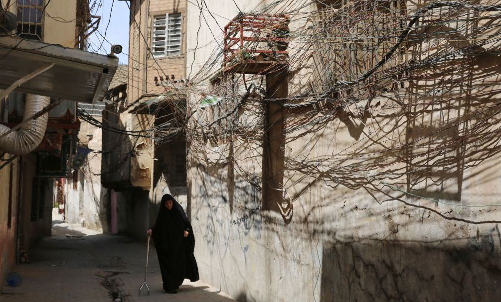 A random web of elctric wires dangle on the walls of a narrow alley in the Iraqi capital Baghdad's Bab Al-Seef neighbourhood on June 11, 2019. (Photo by SABAH ARAR / AFP) (Photo credit should read SABAH ARAR/AFP via Getty Images)