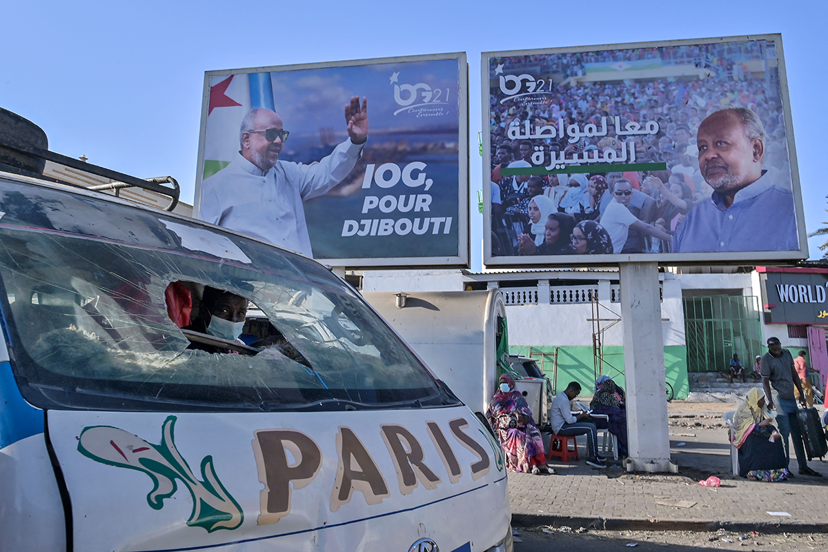A giant campaign banner advertising the candidacy of Djibouti President Ismael Omar Guelleh overlooks the busy main market on the eve of national elections in the capital Djibouti on April 8, 2021. (Photo by TONY KARUMBA/AFP via Getty Images)