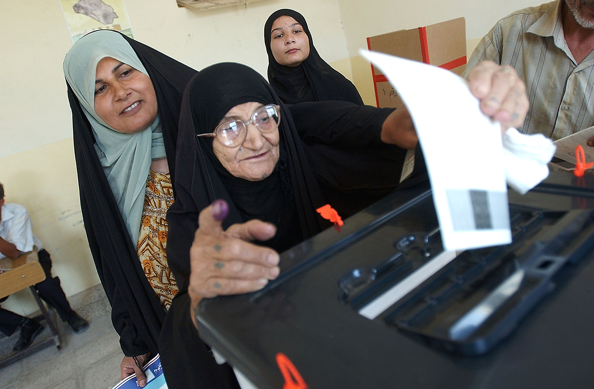 An Iraqi woman votes in a constitutional referendum on October 15, 2005 in the city of Basra. (Photo by Wathiq Khuzaie /Getty Images)