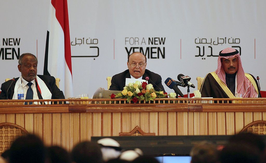 Yemen's President Abed Rabbo Mansour Hadi (C) speaks during the closing ceremony of a National Dialogue Conference aimed at drafting a new constitution and establishing a federal state on January 25, 2014 in Sanaa. (Photo by MOHAMMED HUWAIS/AFP/Getty Images)