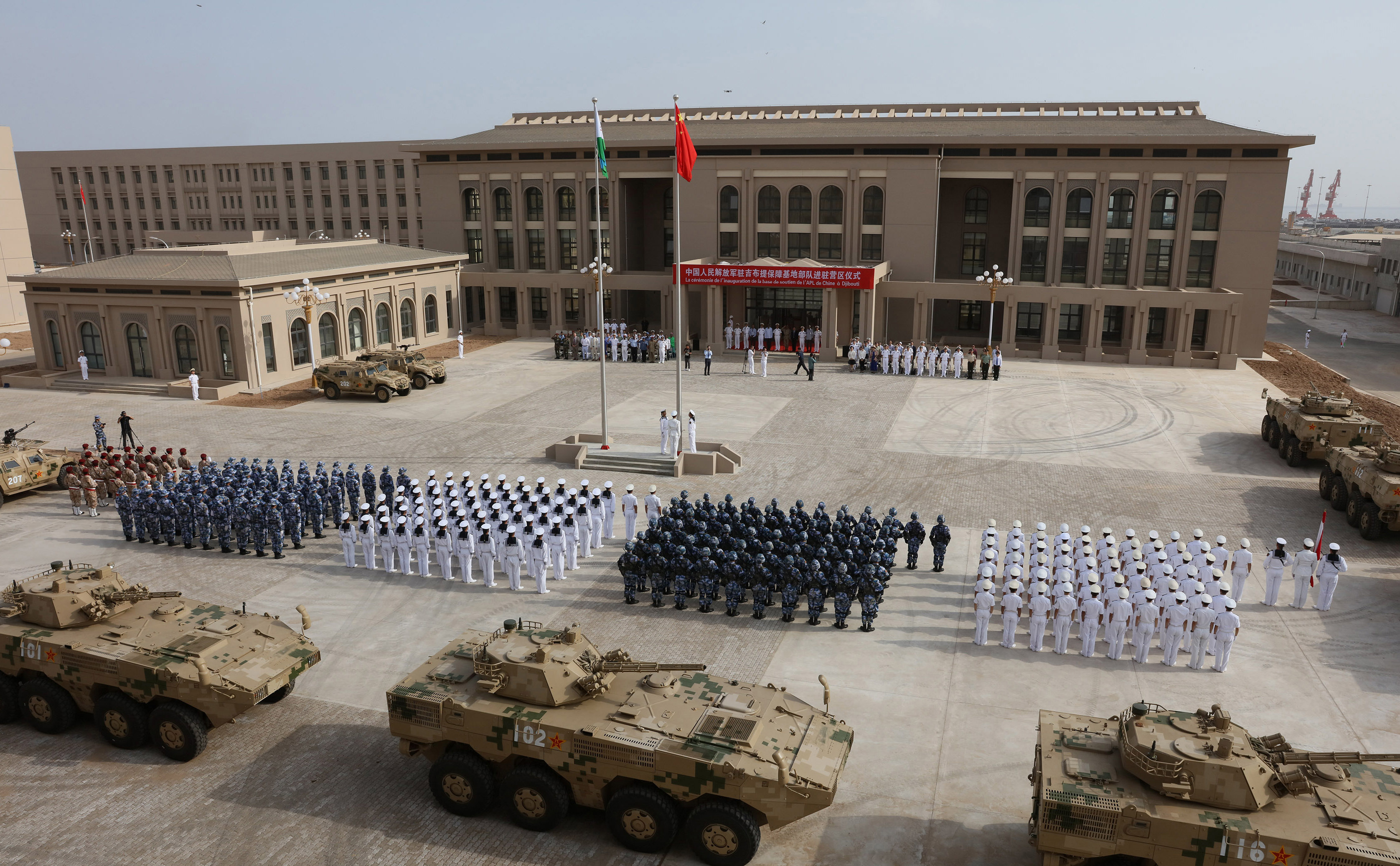This photo taken on August 1, 2017 shows Chinese People's Liberation Army personnel attending the opening ceremony of China's new military base in Djibouti. China has deployed troops to its first overseas naval base in Djibouti, a major step forward for the country's expansion of its military presence abroad. / AFP PHOTO / STR / China OUT (Photo credit should read STR/AFP via Getty Images)