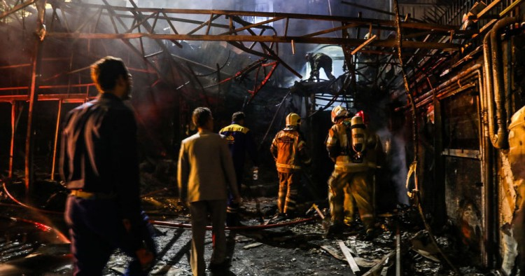 First responders gather at the scene of an explosion at the Sina At'har health centre in the north of Iran's capital Tehran northern Tehran on June 30, 2020.