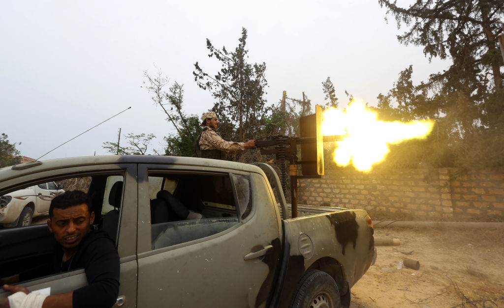 Fighters loyal to the Libyan internationally-recognised Government of National Accord (GNA) fire a heavy machine gun during clashes against forces loyal to strongman Khalifa Haftar, on May 21, 2019 in the Salah al-Din area south of the Libyan capital Tripoli.