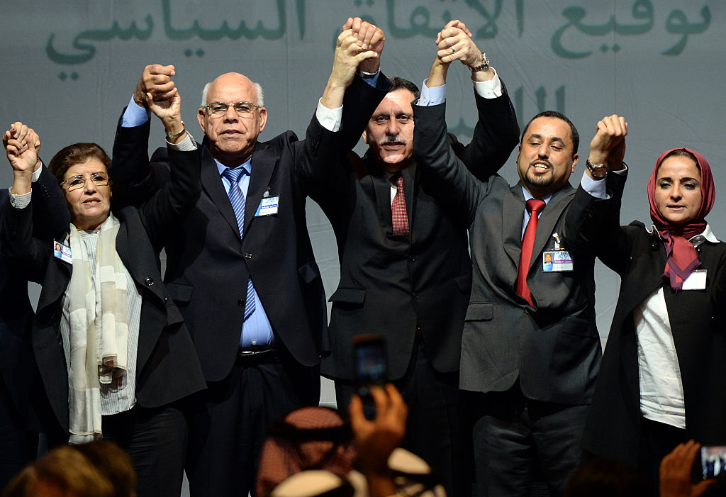Libya's General National Congress (GNC) deputy president Saleh al-Makhzoum (2ndR), the new national government head, Prime Minister, Fayez al-Sarraj (C) and the head of the Tobruk-based House of Representatives Mohammed Ali Shoeb (2ndL) celebrate after signing a deal on a unity government on December 17, 2015, in the Moroccan city of Skhirat.