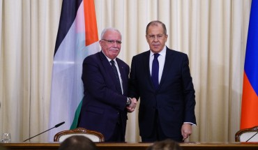 Russian Foreign Minister Sergei Lavrov (R) shakes hand with Palestinian Foreign Minister Riyad al-Malki (L) as they pose for a photo ahead of their press conference in Moscow, Russia on December 21, 2018.