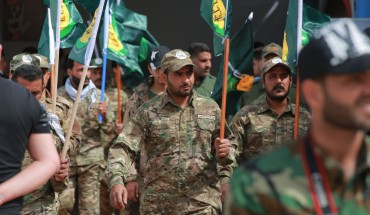 Members of the the predominantly Shia Muslim PMF take part in a PMF conference to honor Iranian fighters who died fighting ISIS