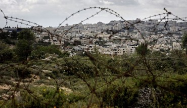 A picture taken from the Israeli settlement of Gilo in Jerusalem, shows the occupied West Bank city of Bethlehem behind barbed wire, on April 17, 2019..