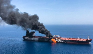 This photo reportedly shows fire and smoke billowing from Norwegian owned Front Altair tanker said to have been attacked in the waters of the Gulf of Oman