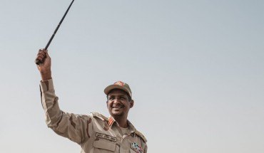 Mohamed Hamdan Dagalo, known as Himediti, deputy head of Sudan's ruling Transitional Military Council (TMC) and commander of the Rapid Support Forces (RSF) paramilitaries, waves a baton to supporters on a vehicle as he arrives for a rally in the village of Abraq, about 60 kilometers northwest of Khartoum, on June 22, 2019. (YASUYOSHI CHIBA/AFP/Getty Images)