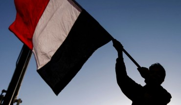 A Yemeni waves a national flag during a rally celebrating the death of Yemeni ex-president Ali Abdullah Saleh a day after he was killed, in the capital Sanaa on December 5, 2017.