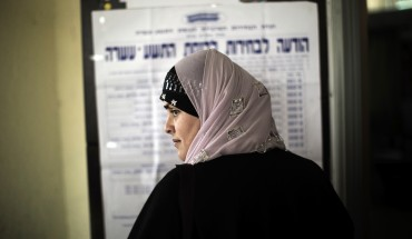 An Arab-Israeli woman waits in line before voting in the northern Israeli village of Maghar January 22, 2013.