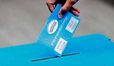 An Israeli man casts his ballot during Israel's parliamentary election, at a polling station in Rosh Haayin, on September 17, 2019.