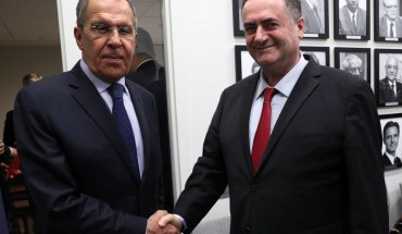 Russia's Foreign Minister Sergei Lavrov (L) and Israel's Foreign Minister Yisrael Katz shake hands during a meeting on the sidelines of the 74th session of the UN General Assembly at the headquarters of the United Nations in Manhattan.