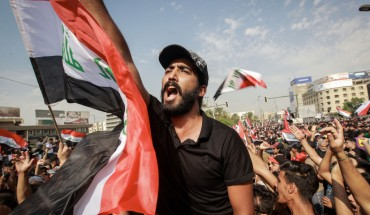 Protesters shout slogans during an anti-government demonstration against the provision of jobs and the alleged government corruption, in Tahrir Square in central Baghdad.