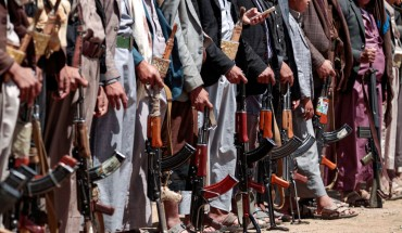 Yemeni men stand with Kalashikov assault rifles during a tribal meeting in the Huthi rebel-held capital Sanaa on September 21, 2019, as tribesmen donate rations and funds to fighters loyal to the Houthis along the fronts.