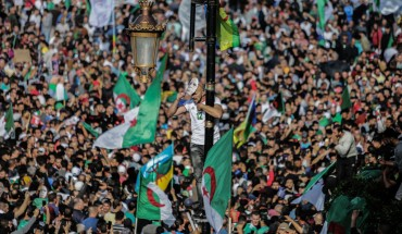 Algerians take part in an anti-government demonstration demanding the ouster of officials who served under ex-president Abdelaziz Bouteflika as they marked the 65th anniversary of the country's fight for independence from France.