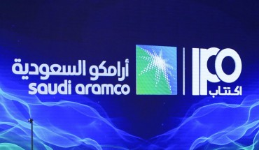 A picture taken on November 3, 2019 shows a sign of Saudi Aramco's initial public offering (IPO) during a press conference by the state company in the eastern Saudi Arabian region of Dhahran.