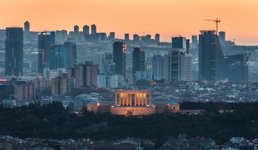 The sunset casts an orange sky over the new urban skyline of Turkey's capital city, Ankara, which is centered around the Anitkabir, the memorial tomb of the country's founding father Mustafa Kemal Ataturk.