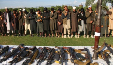 Member of the Islamic state ISIS militants stand alongside their weapons, as they surrendered to government in Jalalabad, Nangarhar, Afghanistan on November 17, 2019.