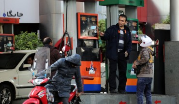 Iranians fill their vehicles at a petrol station in Tehran, on November 15, 2019.