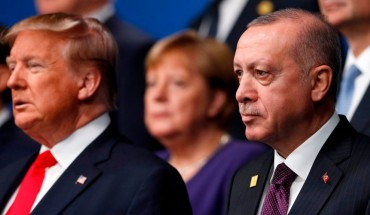US President Donald Trump (L) and Turkey's President Recep Tayyip Erdogan (R) pose for the family photo at the NATO summit at the Grove hotel in Watford, northeast of London on December 4, 2019.