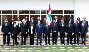 A handout picture provided by the Lebanese photo agency Dalati and Nohra shows Lebanon's Parliament Speaker Nabih Berri (C-L) and President Michel Aoun (C) and prime minister designate Hassan Diab (C-R) posing for a group photo with the newly formed government at the presidential palace in Baabda, east of the capital Beirut, on January 22, 2020.