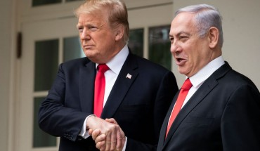 U.S. President Donald Trump and Prime Minister of Israel Benjamin Netanyahu shake hands while walking through the colonnade prior to an Oval Office meeting at the White House March 25, 2019 in Washington, DC.