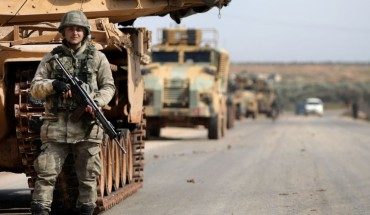 A Turkish soldier stands in front of a military vehicles convoy east of Idlib city in northwestern Syria on February 20, 2020 amid ongoing regime offensive on the last major rebel bastion in the country's northwest.