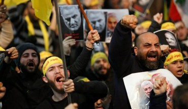 Supporters shout slogans during a rally for Qassem Soleimani in southern suburbs of Beirut, Lebanon, on Jan. 5, 2020. Hezbollah leader Sayyed Hassan Nasrallah urged on Sunday its fighters to attack U.S. soldiers in the region in retaliation for the assassination of Iranian top commander Qassem Soleimani by the United States. (Photo by Bilal Jawich/Xinhua via Getty) (Xinhua/ via Getty Images)