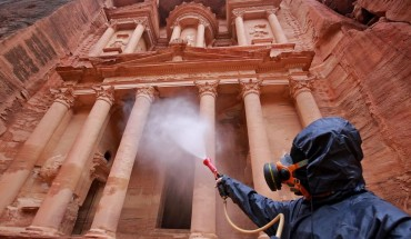 A labourer sprays disinfectant in Jordan's archaeological city of Petra south of the capital Amman on March 17, 2020, to prevent the spread of COVID-19.