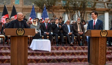 Afghanistan's President Ashraf Ghani (L) speaks as US Secretary of Defense Mark Esper (R) listens during a press conference at the presidential palace in Kabul on February 29, 2020. - The United States signed a landmark deal with the Taliban on February 29, laying out a timetable for a full troop withdrawal from Afghanistan within 14 months as it seeks an exit from its longest-ever war. (Photo by WAKIL KOHSAR / AFP)
