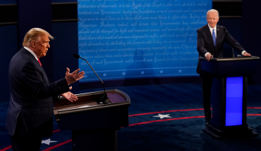 President Donald Trump answers a question as Democratic presidential candidate former Vice President Joe Biden listens during the second and final presidential debate at Belmont University on October 22, 2020 in Nashville, Tennessee. This is the last debate between the two candidates before the election on November 3.