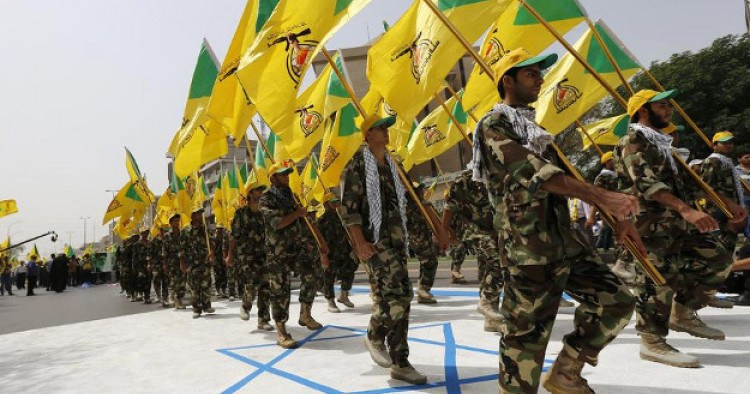 Iraqi Hezbollah soldiers marching with flags