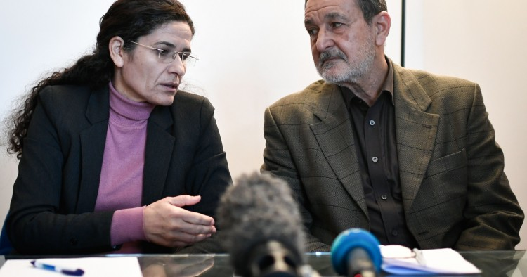 Two top political leaders of the Syrian Kurdish alliance and co-chairs of the Syrian Democratic Council Riad Darar (R) and Ilham Ahmed (L) speak together while delivering a speech during a press-conference, in Paris, on December 21, 2018.