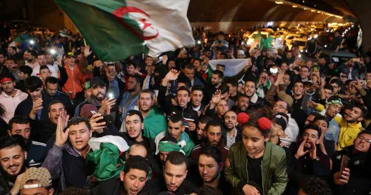 Hundreds of people celebrate during a demonstration after the resignation of Algerian President Abdelaziz Bouteflika, on April 02, 2019 in Algiers, Algeria.