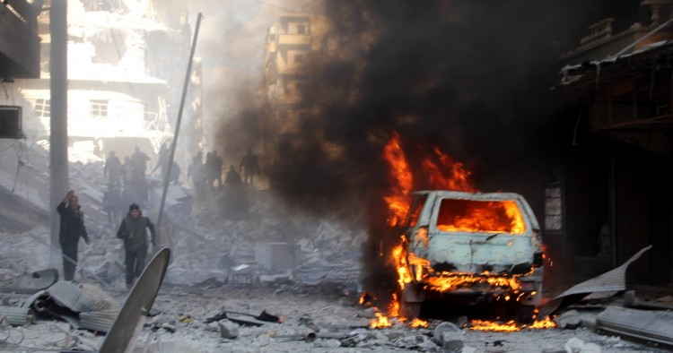 Firefighters extinguish a fire after ISIS terrorists' car-bomb attack against Ahrar ash-Sham Headquarters in Aleppo, Syria on January 25, 2016.