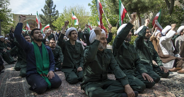 Iranian Clerics chant slogans during an anti-US rally in Tehran on April 14, 2019.