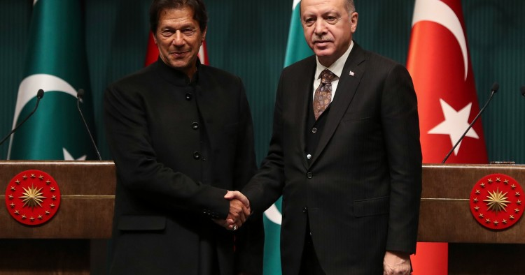 Turkish President Recep Tayyip Erdogan (R) and Pakistani Prime Minister Imran Khan (L) shake hands after a joint press conference at the Presidential Complex in Ankara, on January 4, 2019.
