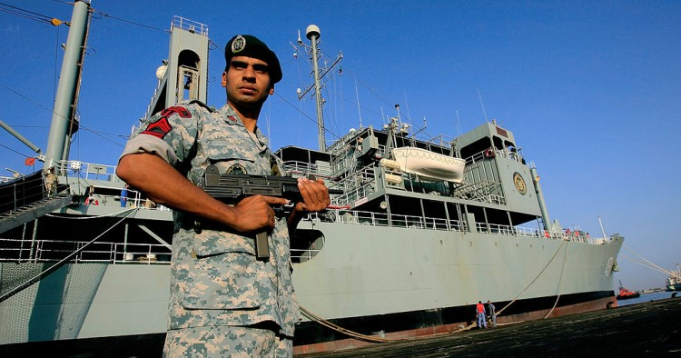 An Iranian navy special forces known as Takavaran wearing a similar uniform worn by the US military and holding an Israeli made Uzi sub-machine gun stands guard near the Iranian Kharg replenishment ship docked in the Red Sea Sudanese town of Port Sudan on October 31, 2012.
