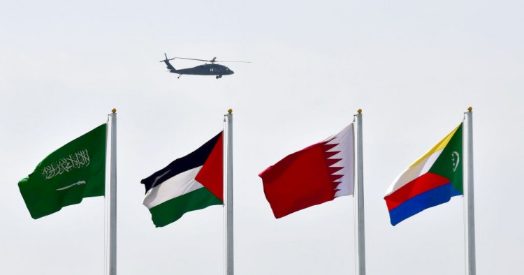 a helicopter flying over flags at the Ithra center during the 29th Summit of the Arab League in Dhahran in Eastern Province, Saudi Arabia on April 15, 2018.