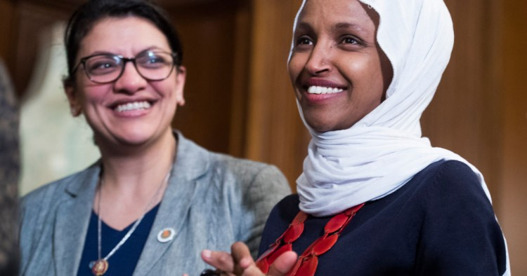 "Reps. Ilhan Omar, D-Minn., right, and Rashida Tlaib, D-Mich., attend a rally with Democrats in the Capitol to introduce the ""Equality Act,"" which will amend existing civil rights legislation to bar discrimination based on gender identification and sexual orientation on Wednesday, March 13, 2019."